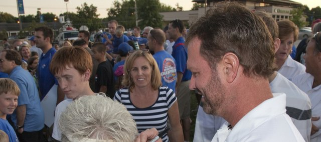 Gail Mealman of Overland Park got her visor autographed by KU men's basketball coach Bill Self on Friday at the Kansas Football Kickoff.