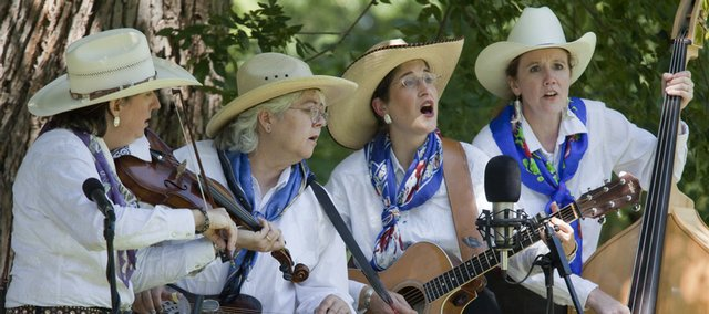 Judy Coder and Cowgirl Swing, from left, Diane Gillenwater, Patti Nance, Judy Coder and Karla Campbell, perform at the 29th annual Kansas State Fiddling and Picking Championships Sunday in South Park.