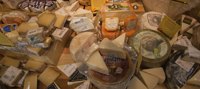 Cheeses from around the world are shown at Dillons, 4701 W. Sixth St.