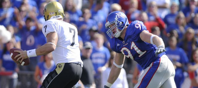 Kansas defensive end Jake Laptad swoops in to sack Colorado quarterback Cody Hawkins for a safety during the second quarter Saturday, Oct. 11, 2008 at Memorial Stadium.