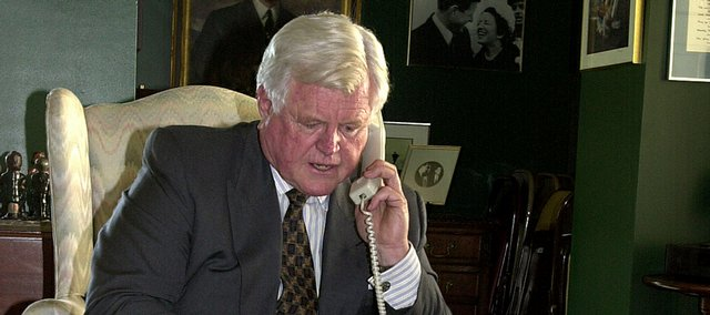 In this Oct. 18, 2001 file photo, Sen. Edward Kennedy, D-Mass., talks to his Boston office from Capitol Hill in Washington following reports of a suspicious package being found in his Boston office. Sen. Edward M. Kennedy of Massachusetts, the last surviving brother in a political dynasty and one of the most influential senators in history, died Tuesday night at his home on Cape Cod after a year-long struggle with brain cancer. He was 77.