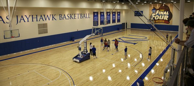 A few of the Kansas women's basketball players work out in the new practice facility. The building was opened for a media tour on Wednesday.