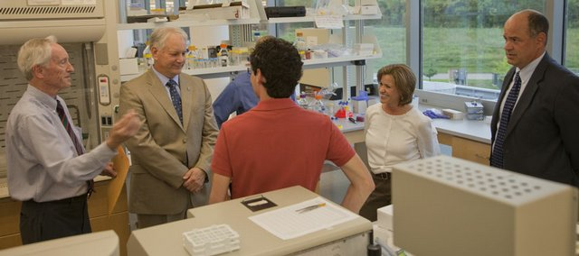 From left, Warren Corman, Kansas University architect, and Ken Audus, dean of the School of Pharmacy, visit with U.S. Rep. Lynn Jenkins, R-Kan., second from right, and Keith Yehle, KU director of government relations, right, during a tour of the Multidisciplinary Research Building on Thursday on KU's West Campus. During Jenkins' visit, she received an update on the construction of KU's new School of Pharmacy building next to the Multidisciplinary building. Both facilities are in Jenkins' 2nd congressional district. At center are aides to Jenkins.