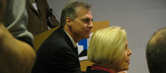 Gov. Mark Parkinson on Tuesday listens before speaking at the annual meeting of the Governor's Council on Fitness that was held at the Topeka-Shawnee County Public Library. Parkinson advocated for a statewide ban on smoking in public places, and said he was evaluating whether to call for an increase in the cigarette tax.