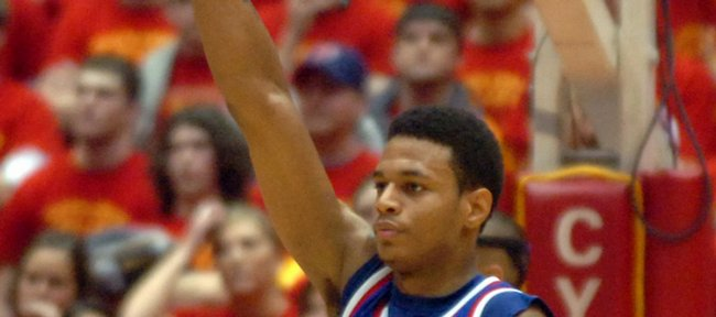 Kansas guard Brandon Rush raises a high fist as the Jayhawks walk off the court with a 68-64 win over Iowa State in overtime at Hilton Coliseum.