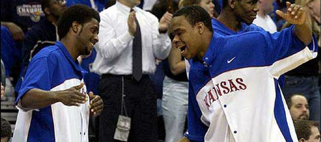 Kansas University's Jeff Hawkins, left, and Michael Lee celebrate a KU basket in this 2003 file photo. Hawkins will be taking over the head coaching job for the Perry-Lecompton boys basketball team.
