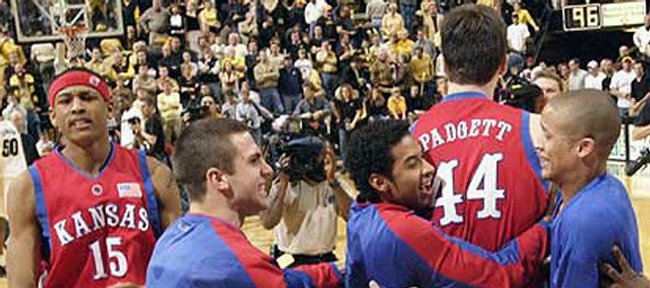 After the final buzzer, Kansas players mob KU freshman David Padgett (44), congratulating him on hitting what proved to be the game-winning shot with two seconds left.