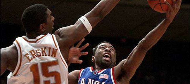 Kansas University's Keith Langford, right, puts up a shot against Texas' Deginald Erskin in the first half of the Jayhawks' 2002 game in Austin, Texas. Though Langford had just two points in that game -- a 110-103 overtime win for KU -- he has fared well in most of his other games in his home state.
