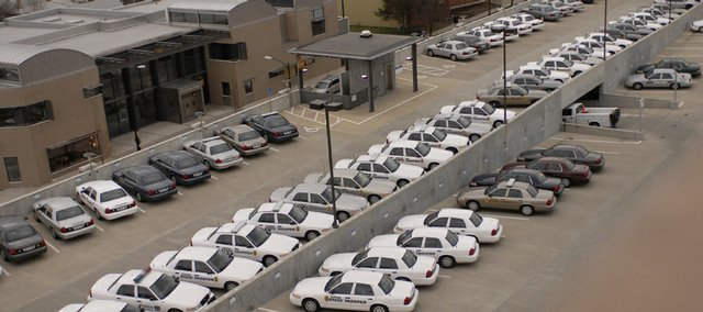 About 70 Kansas Highway Patrol cars converged on the city parking garage at Sixth and New Hampshire streets before the 2008 NCAA Men's Basketball Championship Game in this file photo. In response to the state of the economy, the Kansas Highway Patrol is cutting the number of miles that troopers will travel by 10 percent.