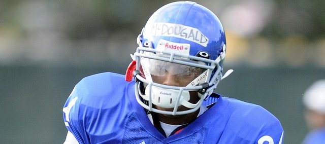 Kansas freshman receiver Bradley McDougald heads up field after pulling in a reception during practice Aug. 11. Coach Mark Mangino has said McDougald is the most impressive true freshman he has seen as a head coach.