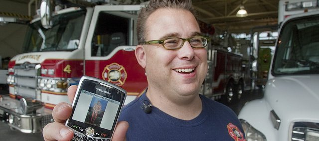 "Paul Schneider, a 42-year-old Lawrence firefighter who weighs 235 pounds, shows off a picture of himself, also shown below, when he weighed under 200 pounds and won fifth place in the Mr. Kansas bodybuilding championships. Schneider's wife has signed him up for ""The Dr. Oz Show,"" which premieres Sept. 14, to help him get healthier and lose a little weight."