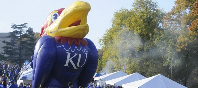 For the first time, biodiesel will provide eco-friendly energy to the generators powering the inflatable Jayhawk, bounce house and slide for kids during Kansas University football games at Memorial Stadium, beginning Saturday. This photo shows pregame festivities in November 2008.