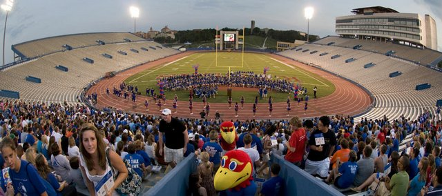 Big Jay and Baby Jay greet new students as they fill the north end of Memorial Stadium for Traditions Night in this file photo from Aug. 18, 2008. A proposed addition on the east side of Memorial Stadium, at left, would produce revenue directed to a $40 million commitment by Kansas Athletics Inc. to academic programs at KU.