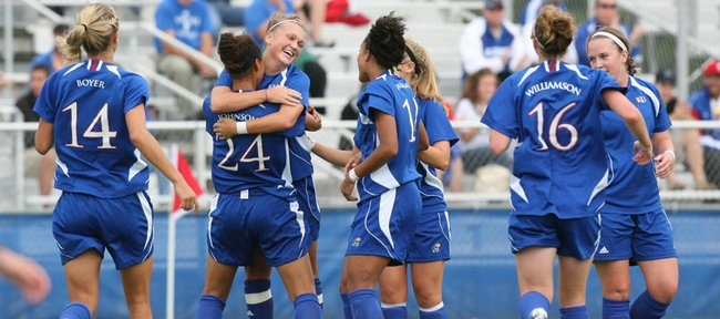 Kansas senior Monica Dolinsky hugs Estelle Johnson (24) after scoring the Jayhawks' first goal against Long Beach State. KU won, 3-1.