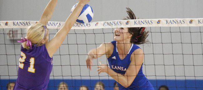 KU's Paige Mazour, right, spikes against a Lipscomb player Friday at the Horejsi Family Athletics Center. At lower right is KU's Melissa Grieb. The Jayhawks are hosting the KU Invite and will play Creighton at 1 p.m. Saturday.