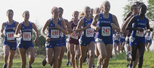 Members of the KU women's cross country team group together during the early part of their 5K run during the Bob Timmons Classic at Rim Rock Farm Saturday, September 5, 2009. Rebeka Stowe (#190) and Kara Windisch (#194) finished first and second, respectively, in the event.