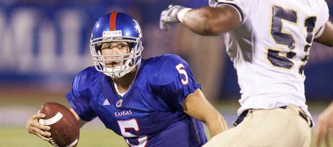 Kansas quarterback Todd Reesing puts a move on Northern Colorado linebacker Cameron Friend during the third quarter Saturday, Sept. 5, 2009 at Memorial Stadium.