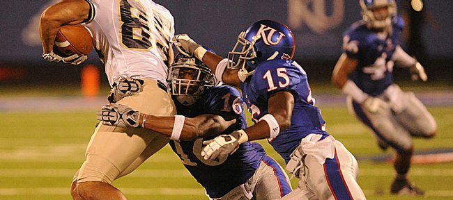 Kansas' Daymond Patterson (15) and Chris Harris (16) team up to bring down Northern Colorado's Darin McDonald. KU beat UNC, 49-3, Saturday at Memorial Stadium.