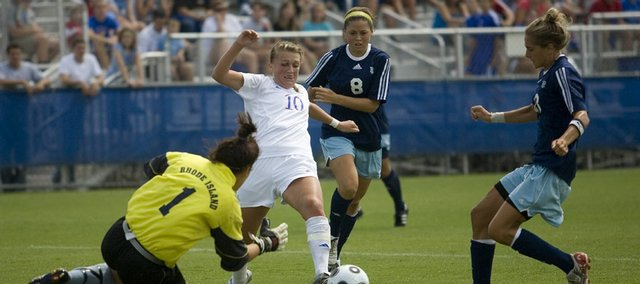 Kansas' Monica Dolinsky (10) tries to fight her way through the Rhode Island defense. Dolinsky had a goal and an assist in the Jayhawks' 3-1 victory on Sunday at the Jayhawk Soccer Complex.