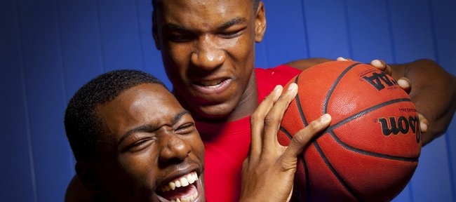 It hasn't taken long for Kansas University freshman roommates Elijah Johnson, front, and Thomas Robinson to develop a true friendship. Johnson explained that while he recovered from a summer knee surgery, Robinson made a constant effort to help him out.