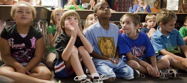 Second-graders at Prairie Park School watch President Barack Obama's address to school children Tuesday.