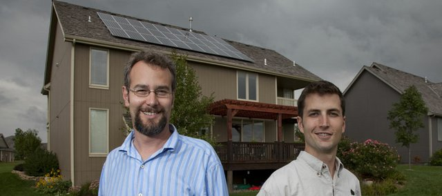 Aron Cromwell, left, CEO of Cromwell Environmental, and Chris Rogge, project manager, created a solar panel array on a home in west Lawrence. The home, at 1638 Bobwhite Drive, will be part of a sustainable homes tour and fair on Saturday.
