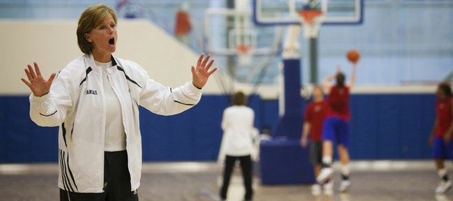 Kansas University women's basketball coach Bonnie Henrickson calls instructions during a group workout Wednesday in the new basketball practice facility. Henrickson has taken to posting team updates on Twitter.
