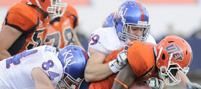 Kansas defenders Jeff Wheeler (84) and Drew Dudley stop UTEP running back Donald Buckram during the second quarter. UTEP rushed for just four yards in a 34-7 loss to the Jayhawks on Saturday in El Paso, Texas.