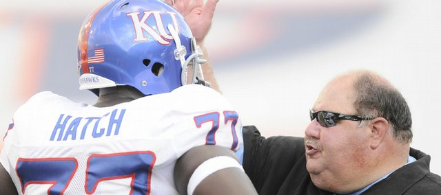 Kansas head coach Mark Mangino pats offensive lineman Jeremiah Hatch on the helmet during the second quarter Saturday, Sept. 12, 2009 at the Sun Bowl in El Paso, Texas.