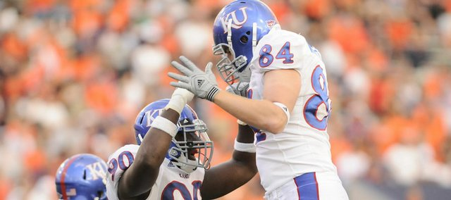 Kansas defenders Maxwell Onyegbule (90) and defensive end Jeff Wheeler celebrate a sack of UTEP quarterback Trevor Vittatoe. KU had six sacks against the Miners.