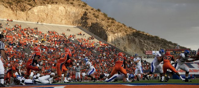 With a backdrop of the Franklin Mountains, Kansas quarterback Todd Reesing (5) drops back to pass against the UTEP defense. Reesing threw for 260 yards in the Jayhawks' 34-7 victory Saturday in El Paso, Texas.
