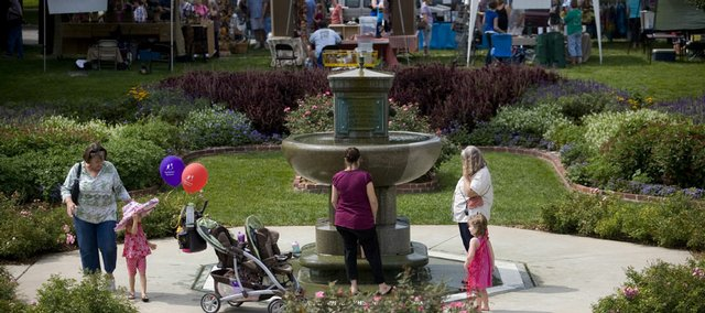 Shoppers pause beside the fountain in South Park during the Fall Arts and Crafts Festival. More than 160 vendors offered their goods Sunday at the 30th annual festival.