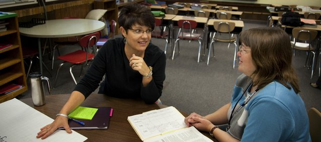 Learning coach Alison Nye, a 27-year Lawrence teacher, left, sits down with first-year teacher Kim Ledbetter at Pinckney School as the two talk about approaches to education on Sept. 1. Nye shares her experience to help mentor first-year teachers in several schools in the district.