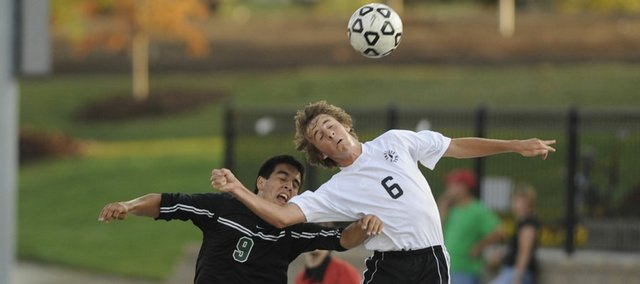 Octavio Villa of DeSoto and Kendal Goodden of Free State compete for a loose ball Monday. Free State shut out DeSoto, 2-0, in the school's home opener.