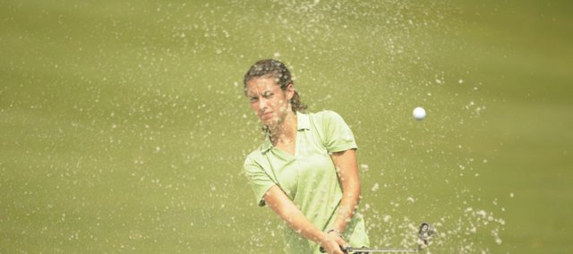 Free State senior Grace Brahler hits out of a sand trap. Brahler shot a 95 on Monday at Lawrence Country Club.