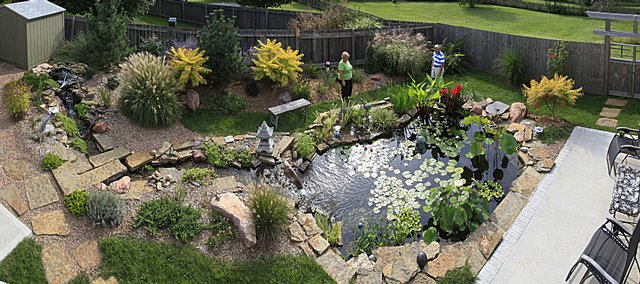 Cheryl and Jim Harmon have a bit of peacefulness in their backyard coming from the large water pond they built. Asian decor complements the tranquil space. Below are details at the Lawrence property.