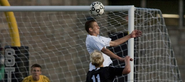 Free State's Elliott Johnson aims for a header to clear out a corner kick.