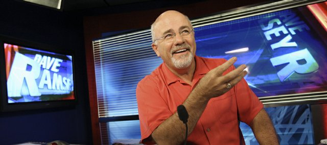 Financial guru Dave Ramsey is seen in his broadcasting studio in Brentwood, Tenn. Ramsey doesn't deny mixing religion and business, and he doesn't apologize for getting rich doing it, either.