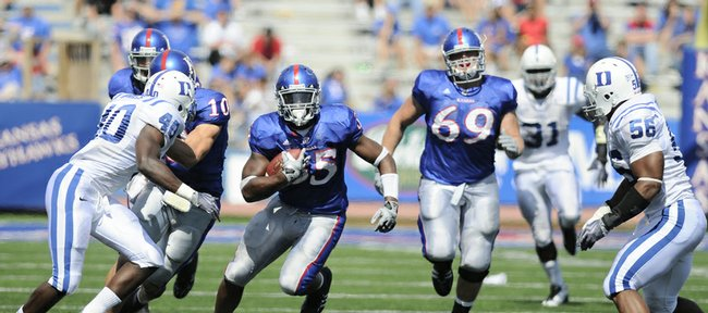 Kansas running back Toben Opurum looks for a hole as he charges up field against the Duke defense during the fourth quarter Saturday at Memorial Stadium.