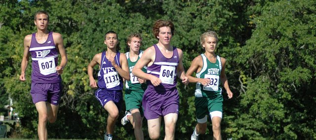 Free State's Logan Sloan, right, battles with Baldwin runners during the Baldwin invitational.
