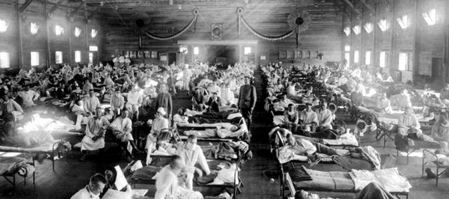 In this 1918 photograph, influenza victims crowd into an emergency hospital at Camp Funston, a subdivision of Fort Riley in Kansas. The flu, which is believed to have originated in Kansas, killed at least 50 million people worldwide.