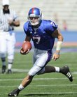 Kansas backup quarterback Kale Pick takes off for a scramble during the fourth quarter Saturday at Memorial Stadium.