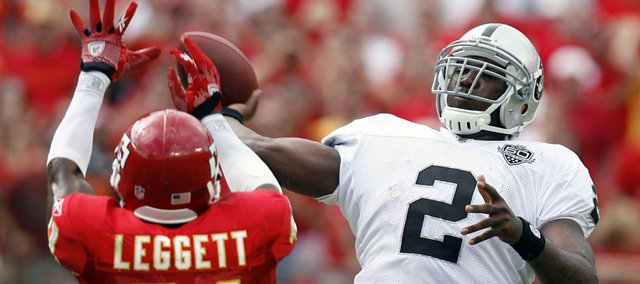 Oakland quarterback JaMarcus Russell (2) throws over Kansas City Chiefs cornerback Maurice Leggett in the fourth quarter. Russell struggled early, but caught fire late to lead the Raiders to a 13-10 victory Sunday in Kansas City, Mo.