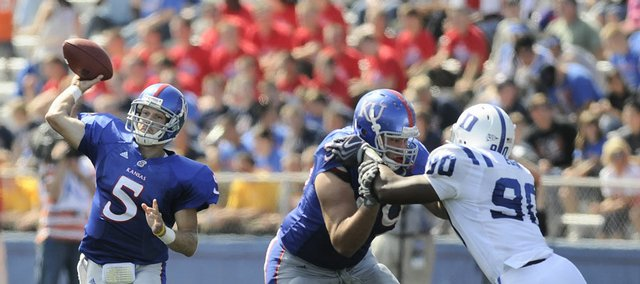 Kansas quarterback Todd Reesing (5) unloads as offensive lineman Sal Capra fends off Duke defensive end Patrick Egboh. Reesing threw for 338 yards against the Blue Devils and was sacked just once in the Jayhawks' 44-16 victory on Saturday at Memorial Stadium.