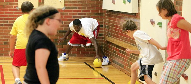KU Basketball player Mario Little prepares to shoot while playing Gladiator during a gym class at Sunset Hill Elementary School on Tuesday, Sept. 22, 2009. KU players exercised with students and promoted healthy habits.