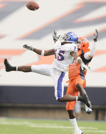 Kansas cornerback Daymond Patterson (15) tips a pass intended for UTEP receiver Jeff Moturi during the second quarter of their game Saturday in El Paso, Texas.