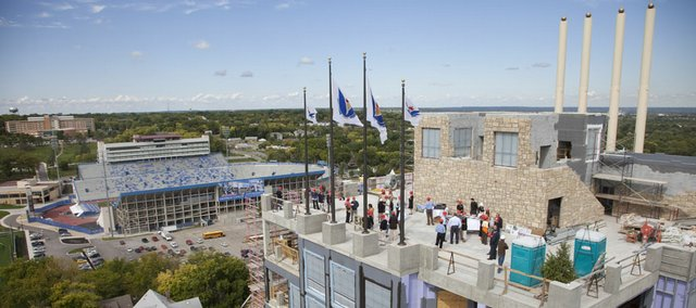 Owners of The Oread, 1200 Oread Ave., along with management, construction members and the media, gather Wednesday on the top-floor observation deck of the structure for a celebration of reaching the height of the building construction.