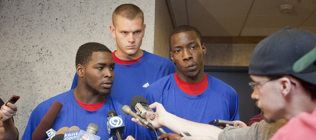 Kansas basketball players, from left, Sherron Collins, Cole Aldrich and Tyshawn Taylor address the media about recent incidents between the basketball and football teams. The players apologized on Thursday at Wagnon Student Athletic Center.