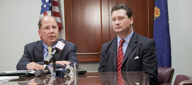 Gene Meyer, Lawrence Memorial Hospital CEO and president, left, and Charles Branson, Douglas County district attorney, discuss efforts to improve services  to rape victims at LMH, Thursday at a news conference.