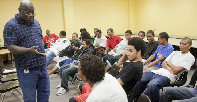 Craig Butler, facilitator of the Courageous Conversations group, a gathering of black students and black adults who discuss everything from school to dating, meets with a group of Free State students.
